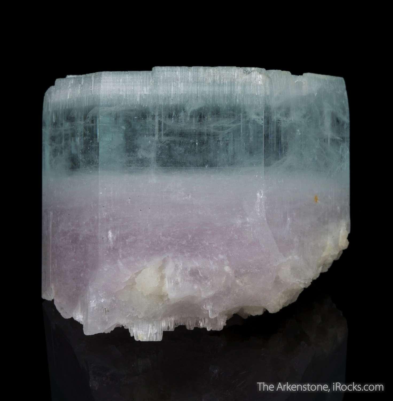A highly unusual crystal specimen beryl showing gemmy blue atop rich