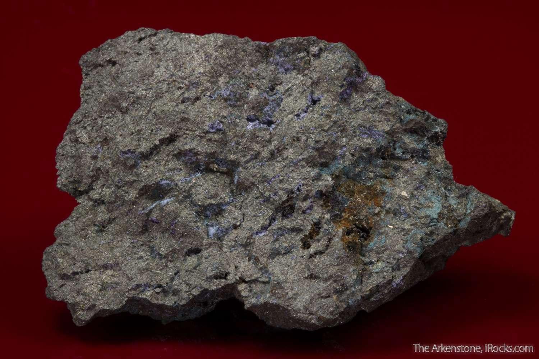 Purple tufts silky micro elyite crystals tiny vugs gray sub metallic