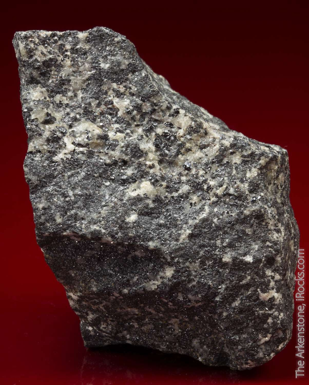 Large granular massive glistening metallic dark gray kentrolite