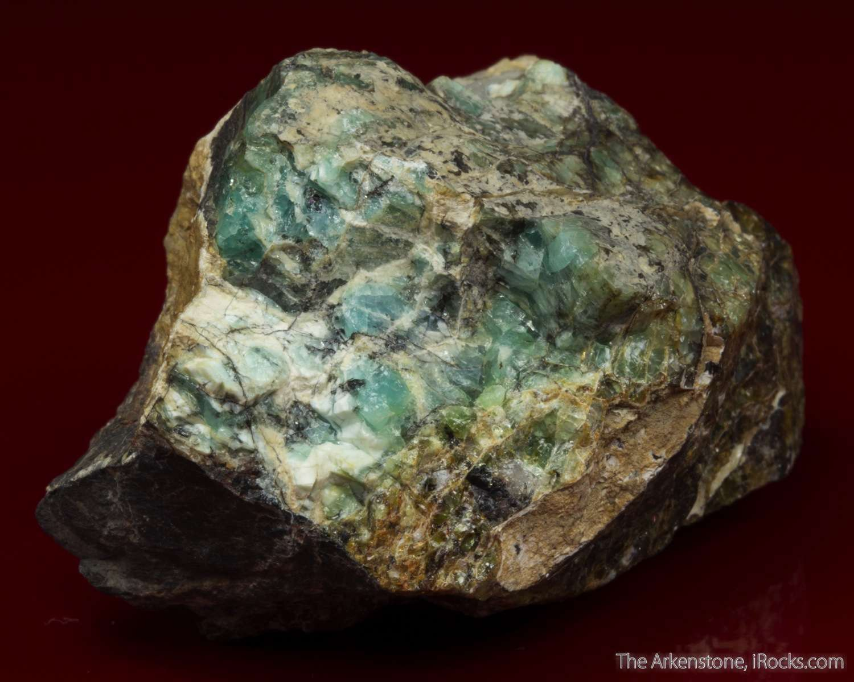 A rich specimen containing aqua colored opalescent masses vashegyite