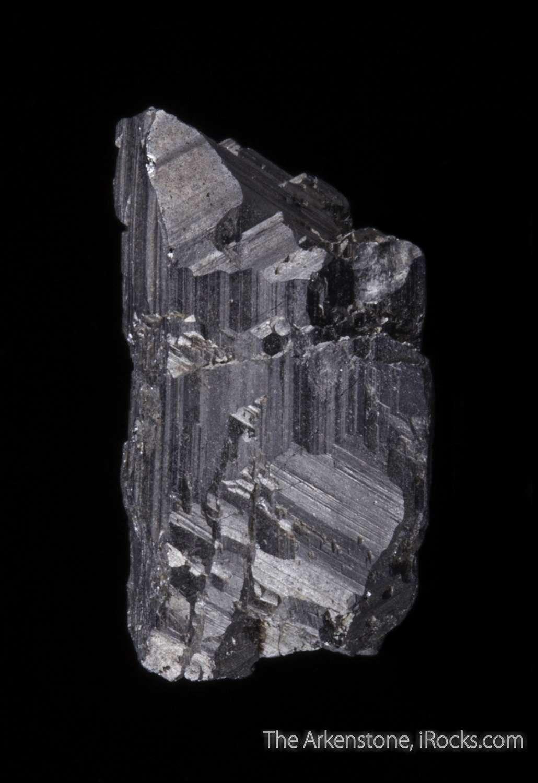 A fine sharp thumbnail specimen displayed horizontally vertically It