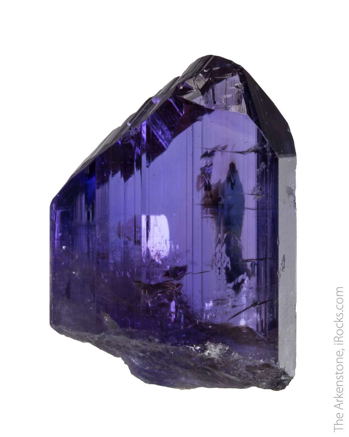This specimen jewel like uncut tanzanite absolutely glassy luster