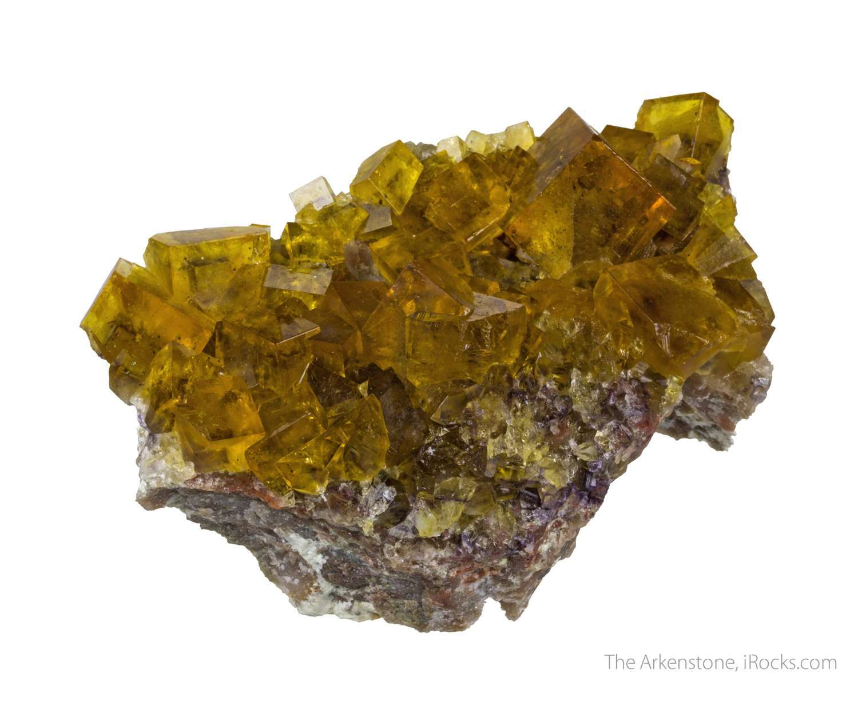 This specimen matrix hosts bright transparent fluorite 2 cm size It