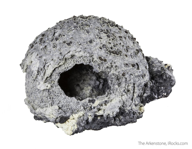 A hemisphere light gray calcite colored minute inclusiosn sphalerite