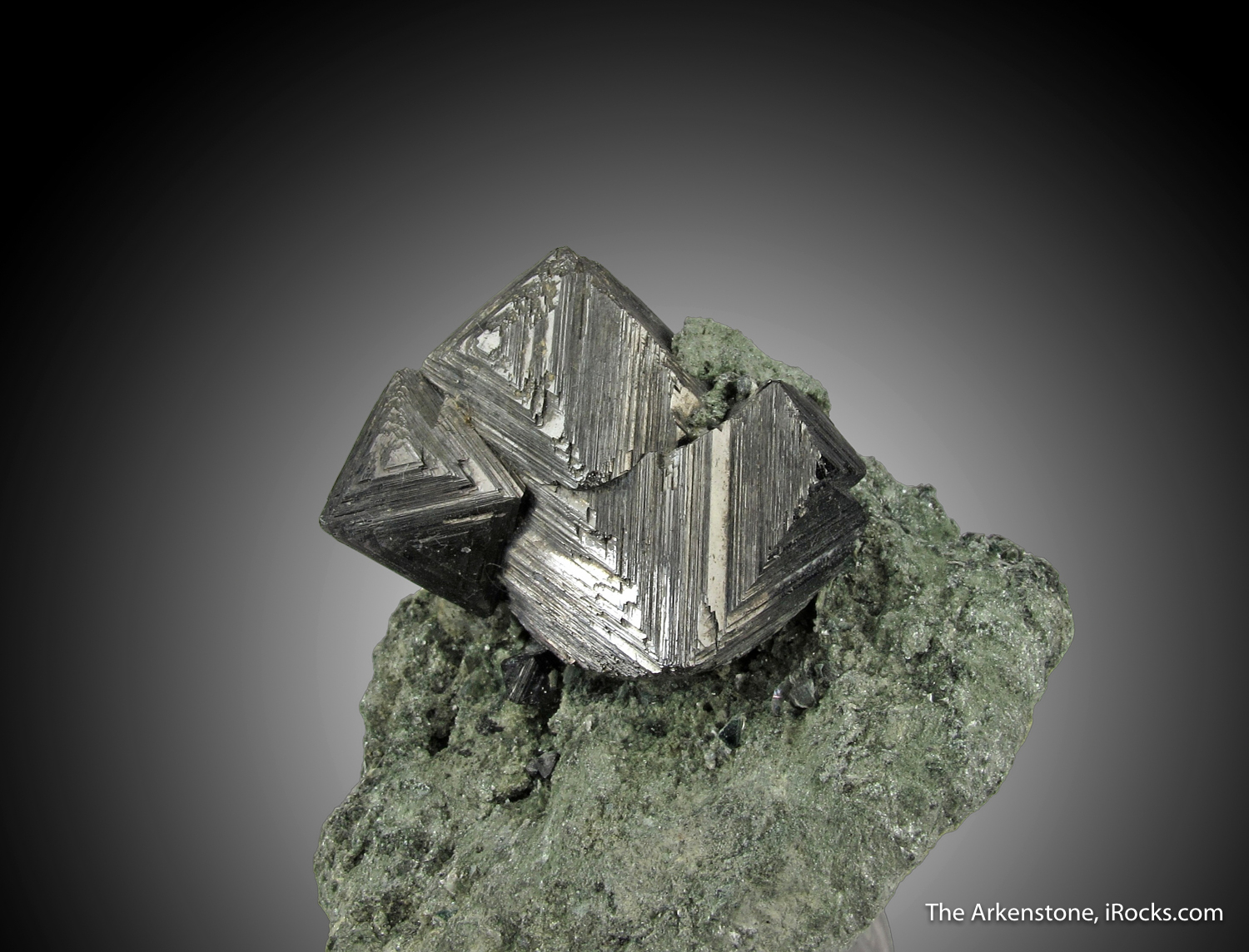 A superb group metallic heavily striated Magnetite octahedrons 2 5 cm