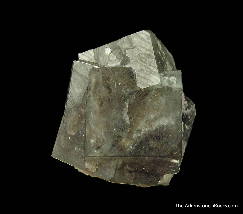 Lustrous translucent dark gray green Boracite crystals measuring 0 9