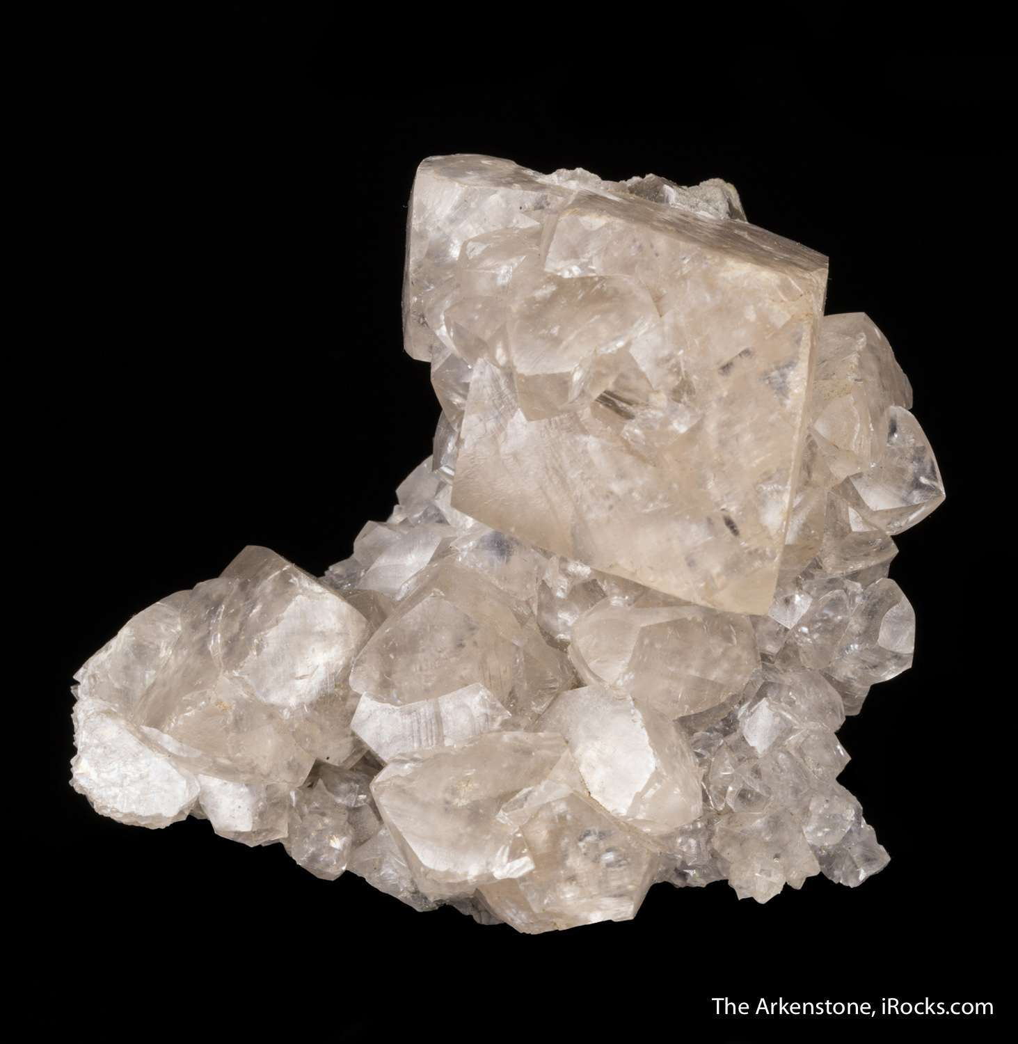 Clustered matrix glassy translucent ivory colored smithsonite crystals