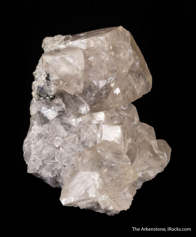 Clustered matrix glassy translucent ivory colored smithsonite crystals
