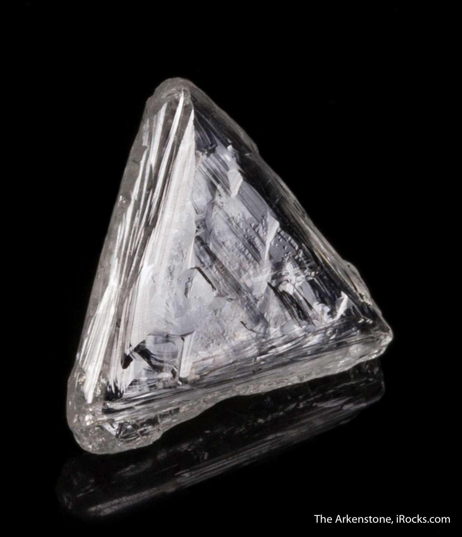 Displaying exquisite adamantine luster limpid clarity uncut 3 32 carat