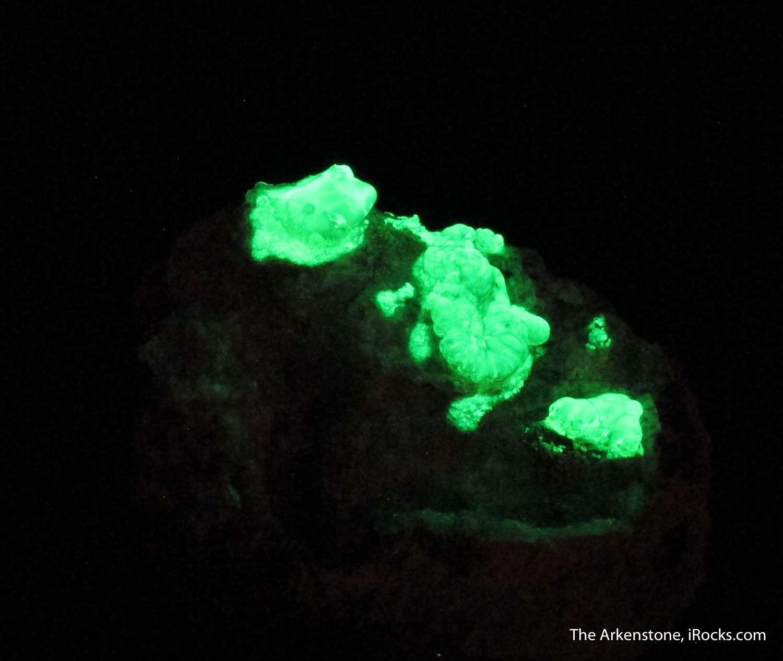 Three islands green fluorescent Hyalite Opal adorn matrix piece