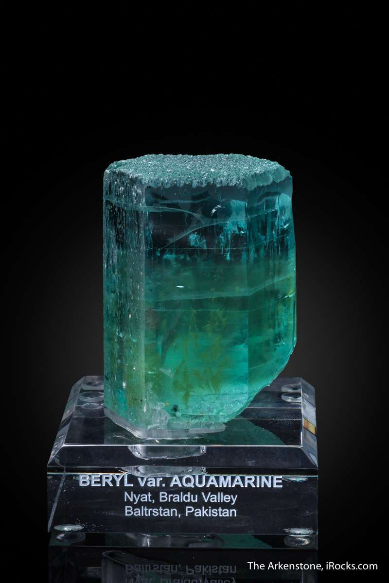 This unique specimen aquamarine overgrowing heliodor core interesting
