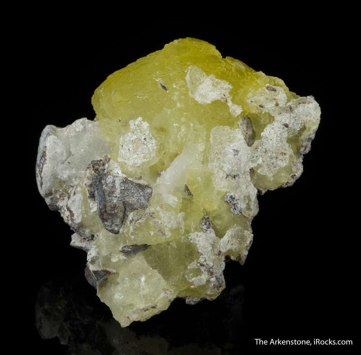Botryoidal glassy partially gemmy vivid yellow brucite measuring 3 cm