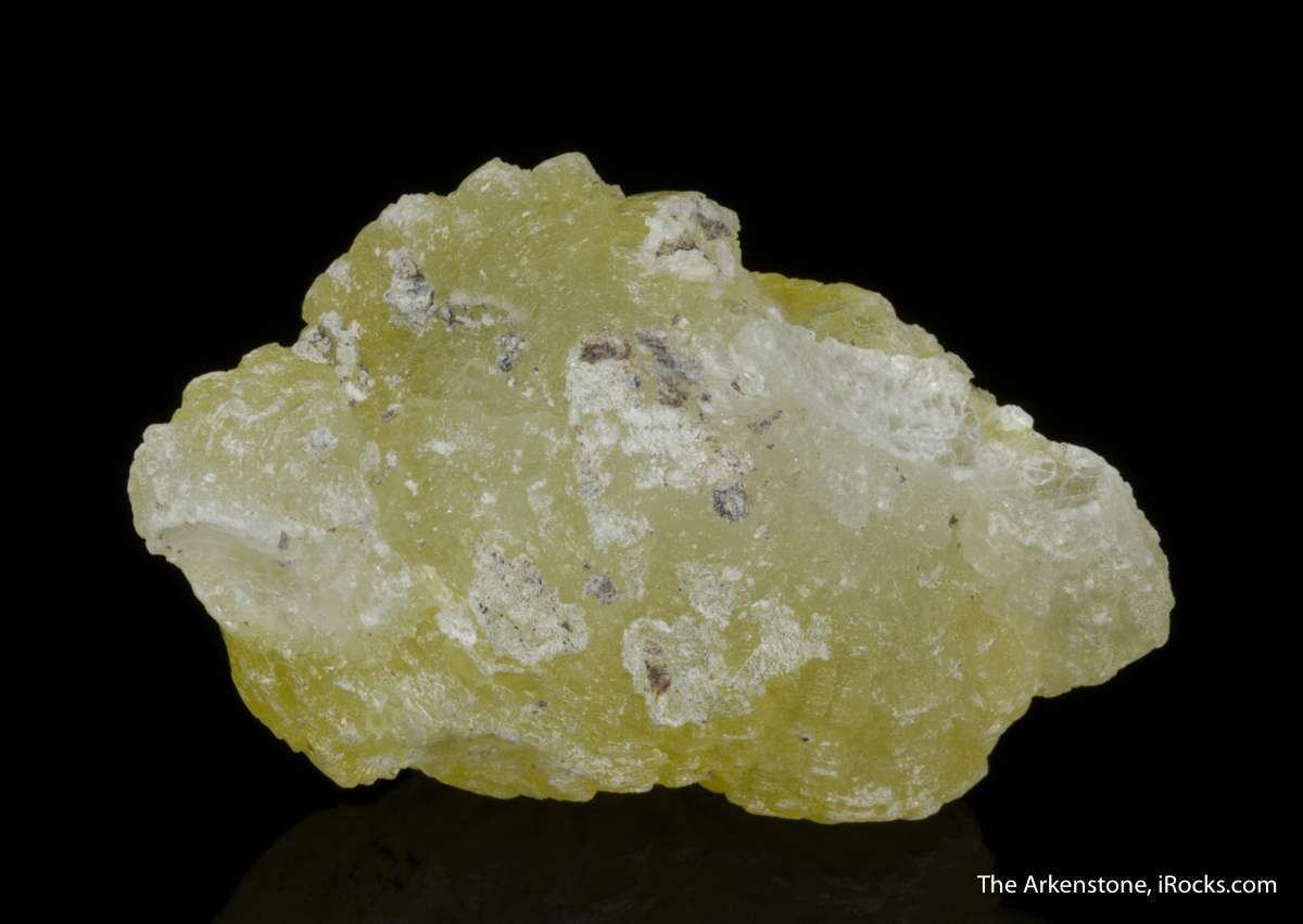 This rounded highly lustrous translucent vivid yellow crystal appears
