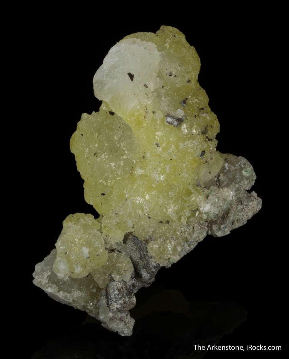 Spherical aggregates lustrous translucent bright lemon yellow brucite