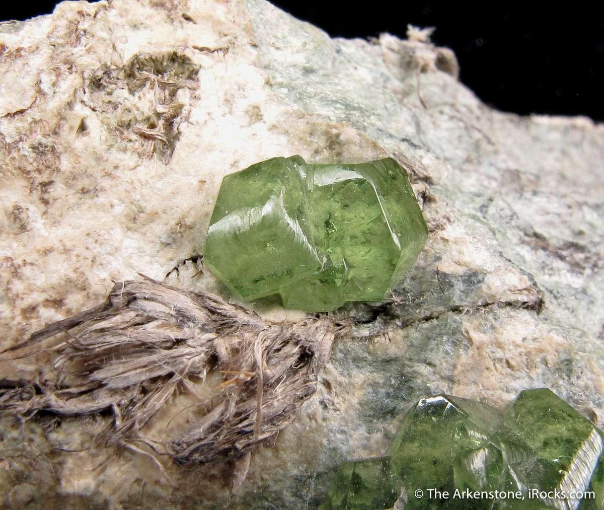 A fine attractive specimen gemmy lustrous apple green Andradite var