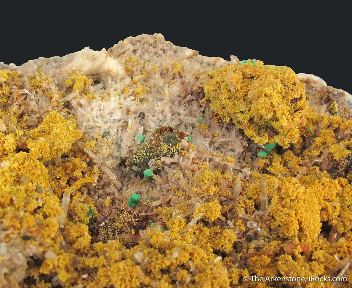 A huge rich museum sized specimen micro crystallized yellow Tsumcorite