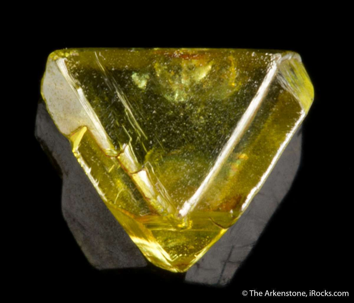 This intense fancy yellow diamond crystal natural shape formed