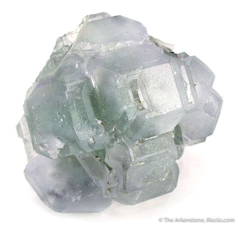 This cluster gemmy interlocked fluorite crystals appears colorless The