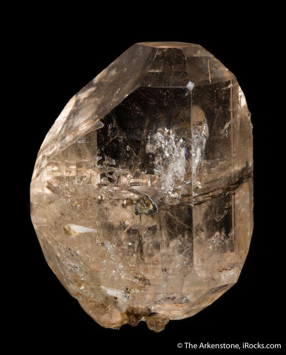 This doubly terminated glassy gemmy champagne colored topaz crystal