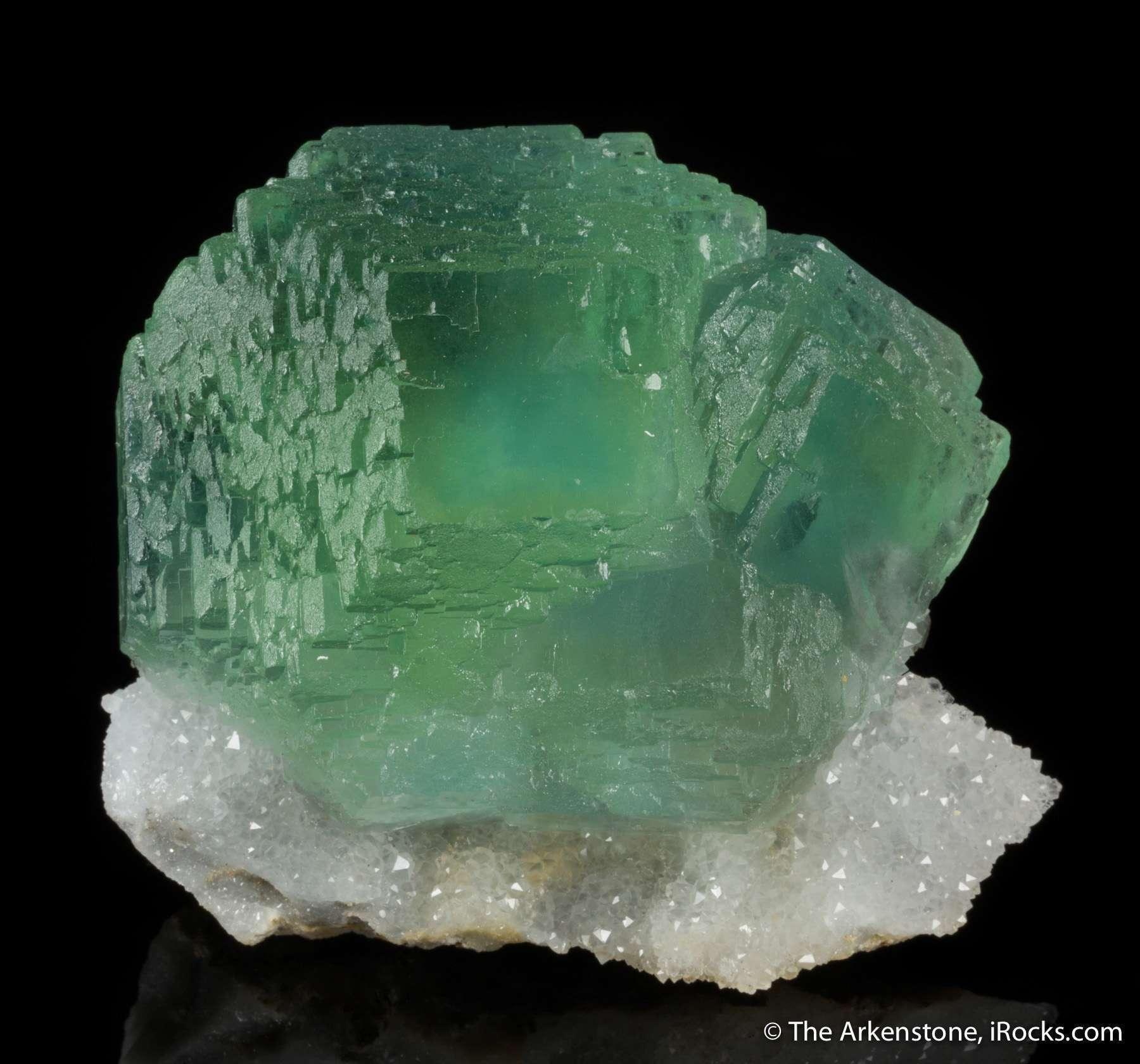 A pedestal drusy sparkling quartz forms matrix intergrown cluster
