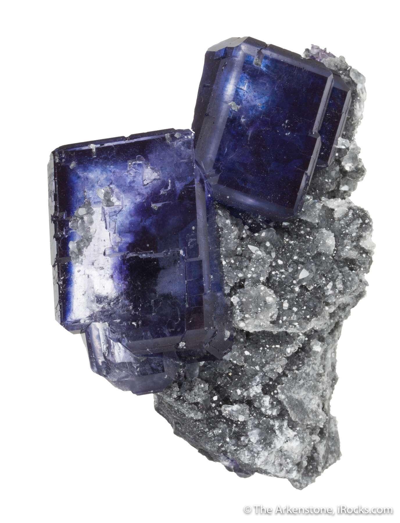 Two large translucent crystals highlight sparkly pedestal matrix