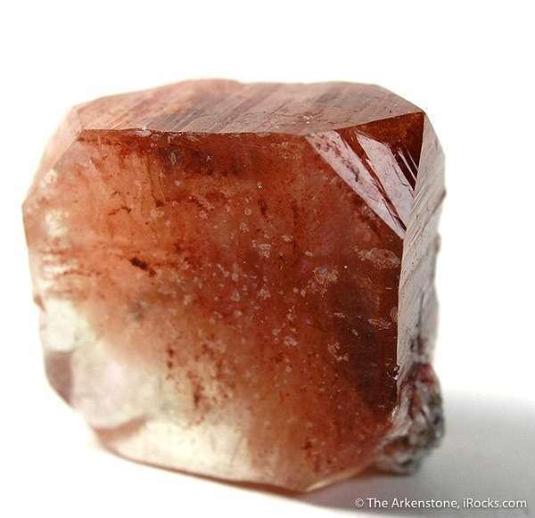 This single tabular FLOATER crystal fluorapophyllite unknown reddish